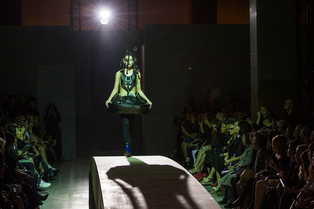 Description of . A model presents a creation as part of Comme Des Garcons ready-to-wear Spring/Summer 2014 fashion collection, presented Saturday, Sept. 28, 2013 in Paris. (AP Photo/Zacharie Scheurer)