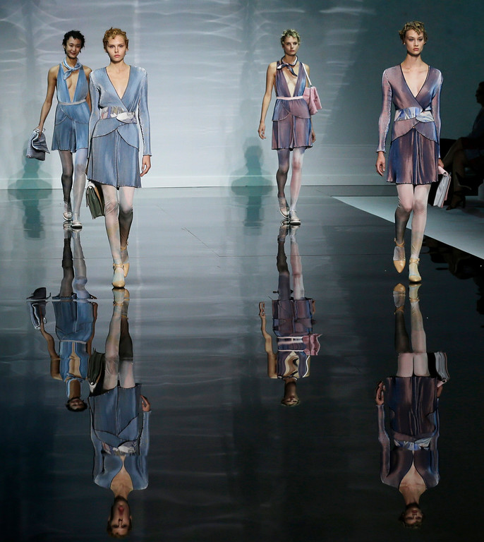 Description of . Models wear creations for Emporio Armani women's Spring-Summer 2014 collection, part of the Milan Fashion Week, unveiled in Milan, Italy, Friday, Sept. 20, 2013. (AP Photo/Luca Bruno)