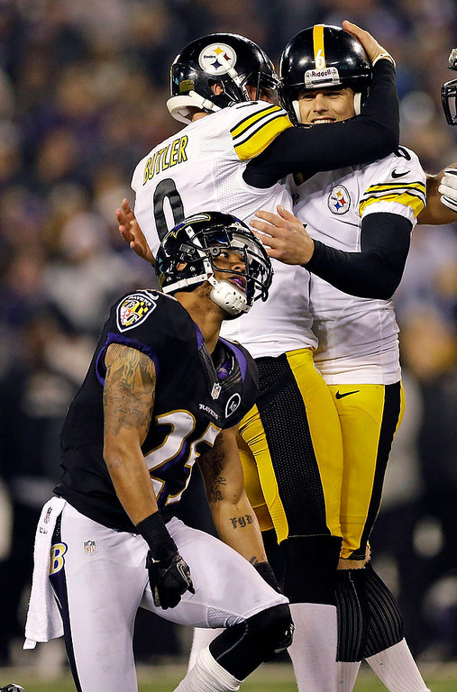 Description of . Pittsburgh Steelers kicker Shaun Suisham, right, is hugged by Drew Butler, left, after making the winning field goal during the second half of an NFL football game against the Baltimore Ravens in Baltimore, Sunday, Dec. 2, 2012. Baltimore. Ravens cornerback Asa Jackson looks past following the play. The Steelers won 23-20. (AP Photo/Patrick Semansky)