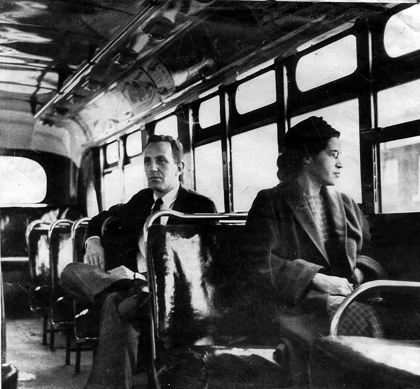 Description of . Rosa Parks rides on the Montgomery Area Transit System bus. Parks, whose refusal to give up her bus seat to a white man sparked the modern civil rights movement, died Monday Oct. 24, 2005. She was 92. (AP Photo/Montgomery Advertiser)