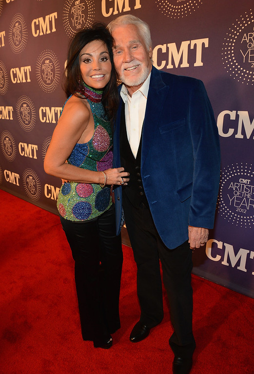 Description of . Wanda Rogers and Kenny Rogers attend 2012 CMT Artists Of The Year at The Factory at Franklin on December 3, 2012 in Franklin, Tennessee.  (Photo by Rick Diamond/Getty Images for CMT)
