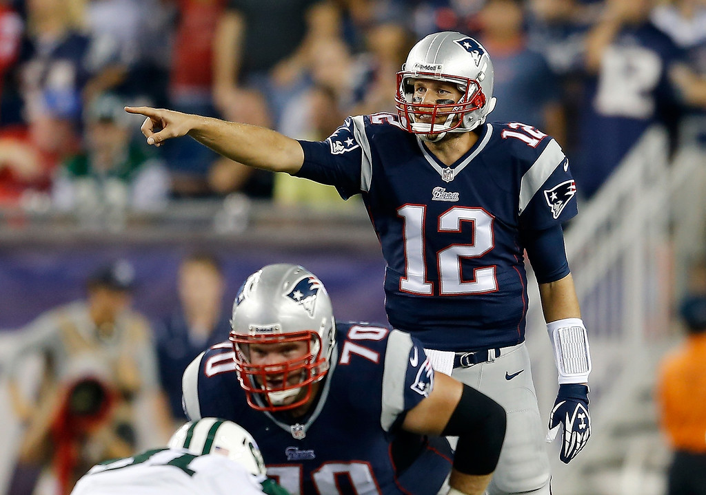 Description of . Quarterback Tom Brady #12 of the New England Patriots calls out from under center in the first half while taking on the New York Jets at Gillette Stadium on September 12, 2013 in Foxboro, Massachusetts.  (Photo by Jim Rogash/Getty Images)