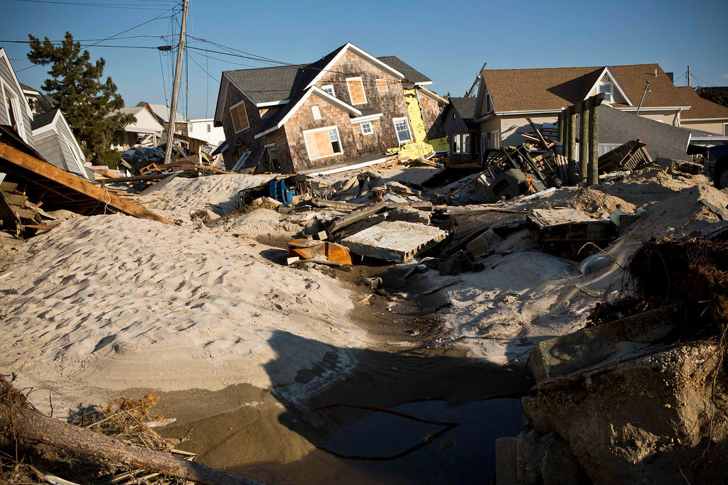 Description of . Homes destroyed by Hurricane Sandy are seen, one month after the storm made landfall, in Mantoloking, New Jersey, November 29, 2012. REUTERS/Andrew Burton