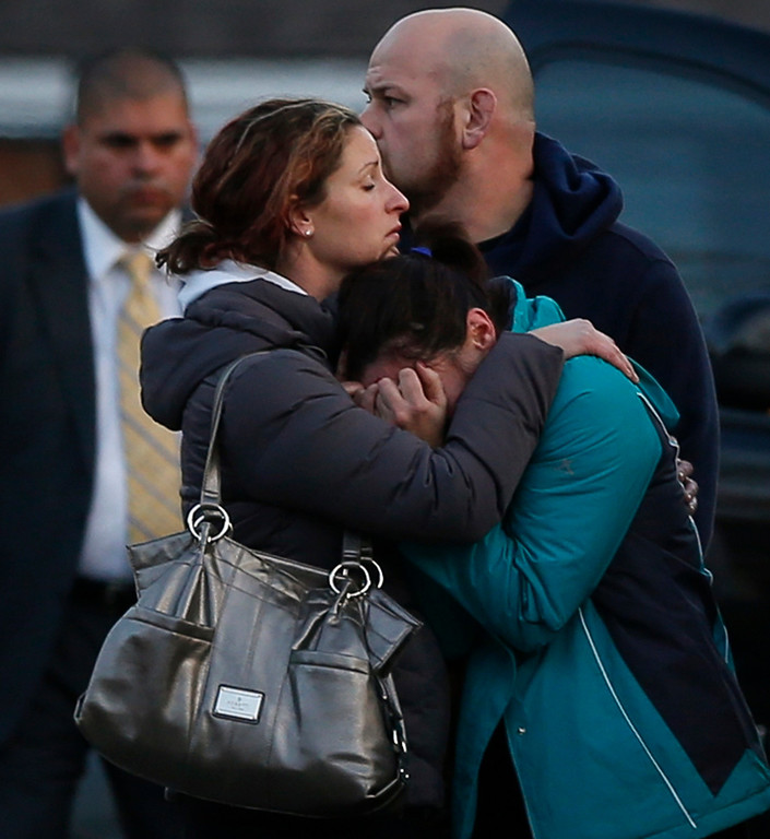 Description of . The families of victims grieve near Sandy Hook Elementary School, were a gunman opened fire on school children and staff in Newtown, Connecticut on December 14, 2012. A heavily armed gunman opened fire on school children and staff at a Connecticut elementary school on Friday, killing at least 26 people, including 20 children, in the latest in a series of shooting rampages that have tormented the United States this year. REUTERS/Adrees Latif