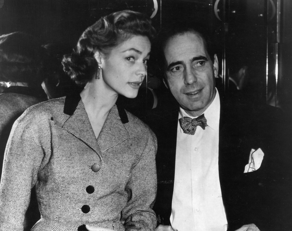 . 16th April 1951:  Humphrey De Forest Bogart (1899 - 1957), American film actor with his wife Lauren Bacall, originally Betty Joan Perske, an American actress.  (Photo by Victor Drees/Evening Standard/Getty Images)