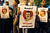 Pro-Mursi supporters hold banners reading 