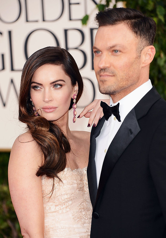 Description of . Actress Megan Fox (L) and actor Brian Austin Green arrive at the 70th Annual Golden Globe Awards held at The Beverly Hilton Hotel on January 13, 2013 in Beverly Hills, California.  (Photo by Jason Merritt/Getty Images)