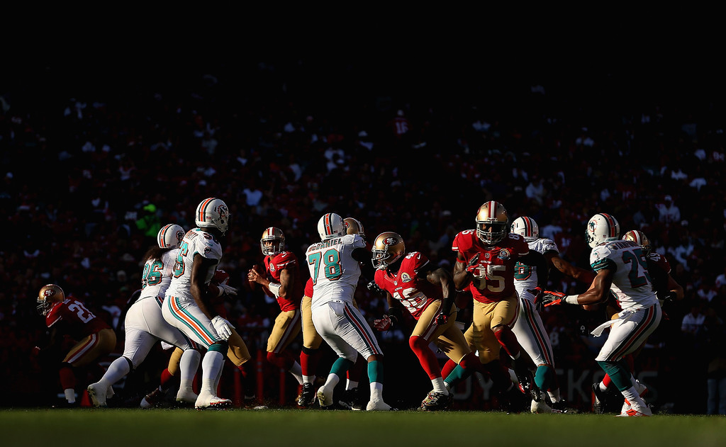 Description of . SAN FRANCISCO, CA - DECEMBER 09: Colin Kaepernick #7 of the San Francisco 49ers drops back to pass while they run a pass play against the Miami Dolphins at Candlestick Park on December 9, 2012 in San Francisco, California.  (Photo by Ezra Shaw/Getty Images)