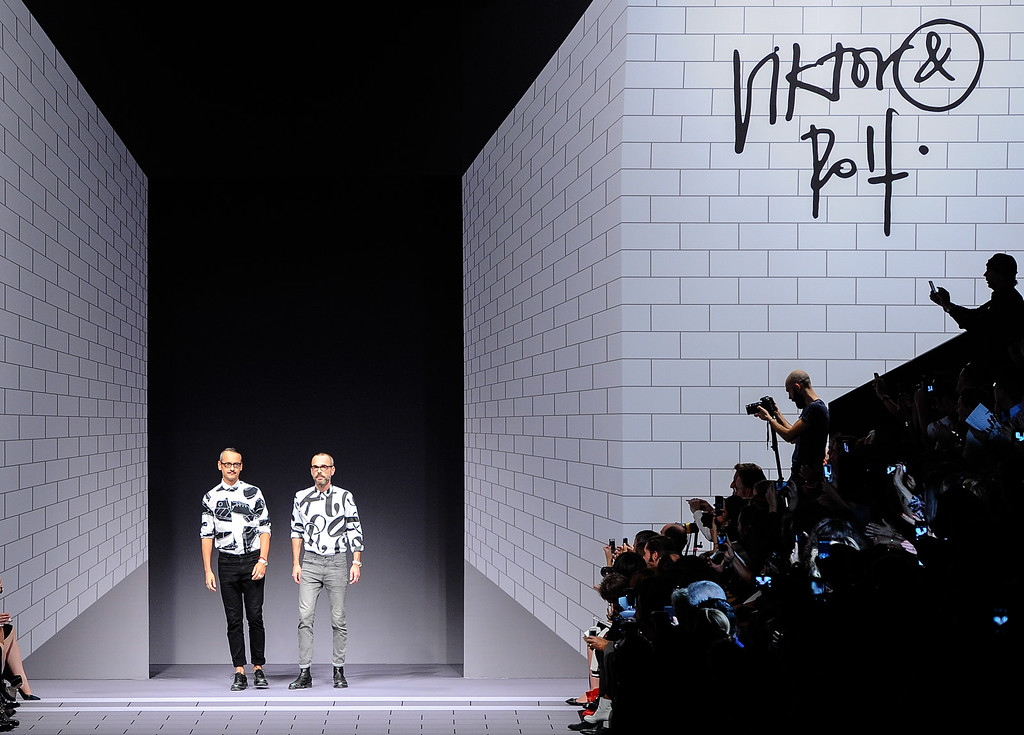 Description of . Fashion designers Viktor Horsting and Rolf Snoeren acknowledge applause the end of the Viktor and Rolf ready-to-wear Spring/Summer 2014 fashion collection, presented Saturday, Sept. 28, 2013 in Paris. (AP Photo/Zacharie Scheurer)