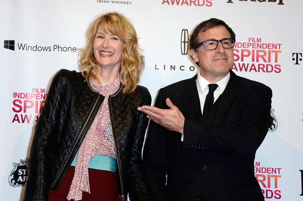 Description of . SANTA MONICA, CA - FEBRUARY 23:  (L-R) Actress Laura Dern and director David O. Russell pose in the press room during the 2013 Film Independent Spirit Awards at Santa Monica Beach on February 23, 2013 in Santa Monica, California.  (Photo by Frazer Harrison/Getty Images)