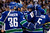 From left, Vancouver Canucks' Jannik Hansen, Kevin Bieksa, Chris Higgins and Jason Garrison celebrate Garrison's goal against the Colorado Avalanche during the first period of an NHL hockey game in Vancouver, British Columbia, on Wednesday, Jan. 30, 2013. (AP Photo/The Canadian Press, Darryl Dyck)
