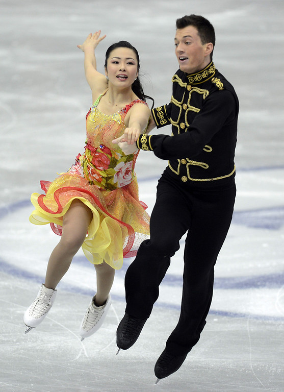 Description of . Emi Hirai and Marien De La Asuncion of Japan skate in the Ice Dance Short Dance during day one of the ISU Four Continents Figure Skating Championships at Osaka Municipal Central Gymnasium on February 8, 2013 in Osaka, Japan.  (Photo by Atsushi Tomura/Getty Images)