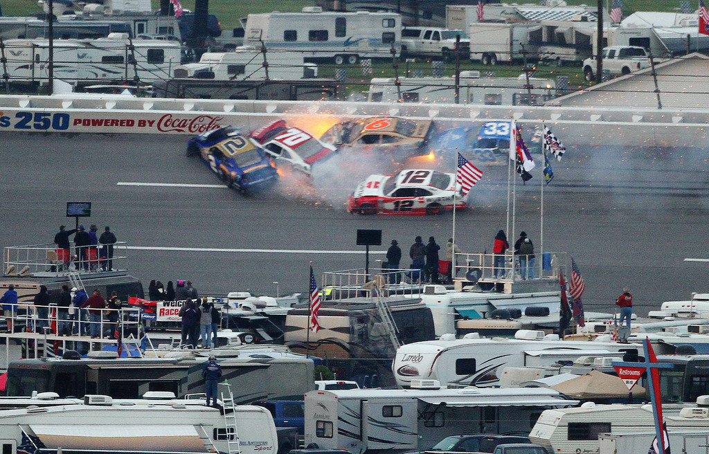 Description of . Brian Scott (2) crashes with Johanna Long (70), Trevor Bayne (6), Ty Dilon (33) and Sam Hornish Jr. (12) in Turn 3 during the NASCAR Nationwide Series auto race at the Talladega Superspeedway in Talladega, Ala., Saturday, May 4, 2013. (AP Photo/Jay Alley)