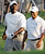 Tiger Woods, right, and Michael Jordan, left, share a laugh as they walk down the first fairway during the pro-am for the Wachovia Championship golf tournament at Quail Hollow Club in Charlotte, N.C., Wednesday, May 2, 2007. (AP Photo/Chuck Burton)