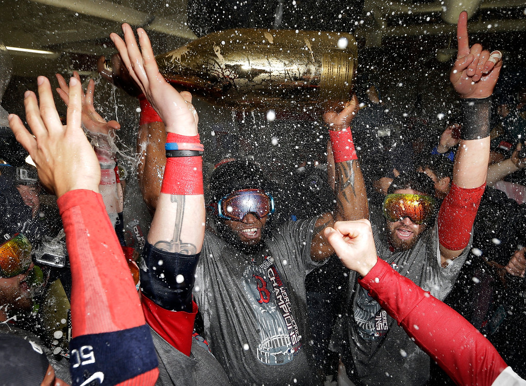 Description of . Boston Red Sox's David Ortiz celebrates with teammates after Game 6 of baseball's World Series against the St. Louis Cardinals Thursday, Oct. 31, 2013, in Boston. The Red Sox won 6-1 to win the series. Ortiz was names the series MVP. (AP Photo/David J. Phillip)