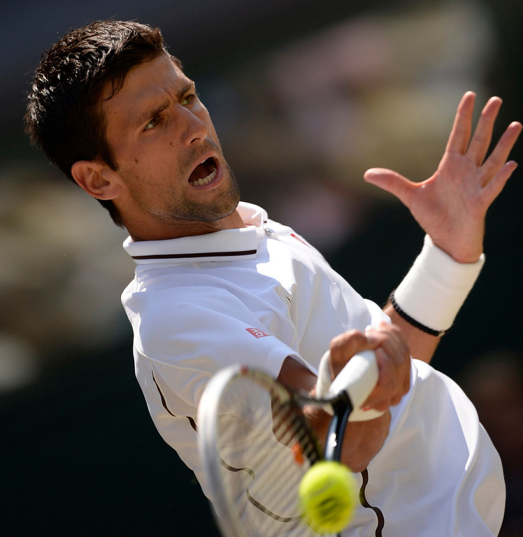 Description of . Serbia's Novak Djokovic returns against Britain's Andy Murray during the men's singles final on day thirteen of the 2013 Wimbledon Championships tennis tournament at the All England Club in Wimbledon, southwest London, on July 7, 2013. ADRIAN DENNIS/AFP/Getty Images