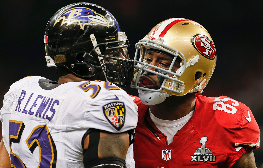 Description of . Baltimore Ravens linebacker Ray Lewis (52) exchanges words with San Francisco 49ers tight end Vernon Davis (85) in the second quarter of the NFL Super Bowl XLVII football game, Sunday, Feb. 3, 2013, in New Orleans. (AP Photo/Julio Cortez)