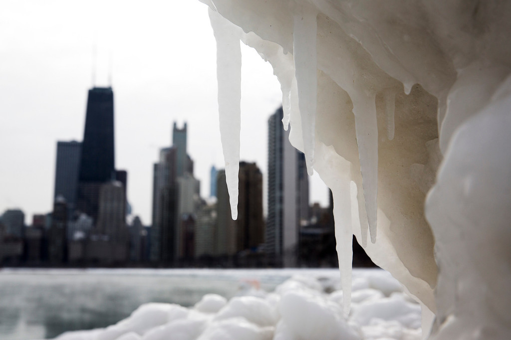 . The Chicago skyline is photographed behind a large chunk of ice near North Avenue Beach as cold temperatures remain with wind chills nearing minus 30 Fahrenheit on Tuesday, Jan. 7, 2014, in Chicago. Dangerously cold polar air snapped decades-old records as it spread Tuesday from the Midwest to southern and eastern parts of the U.S. and eastern Canada, making it hazardous to venture outside and keeping many schools and businesses closed. (AP Photo/Andrew A. Nelles)