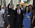 Nicaraguan President Daniel Ortega(L) raises his fist next to Venezuelan Foreign Minister Elias Jaua(C) and Nicaraguan first lady Rosario Murillo outside of the funeral of the late President Hugo Chavez, in Caracas, on March 8, 2013. AFP PHOTO/STRSTR/AFP/Getty Images