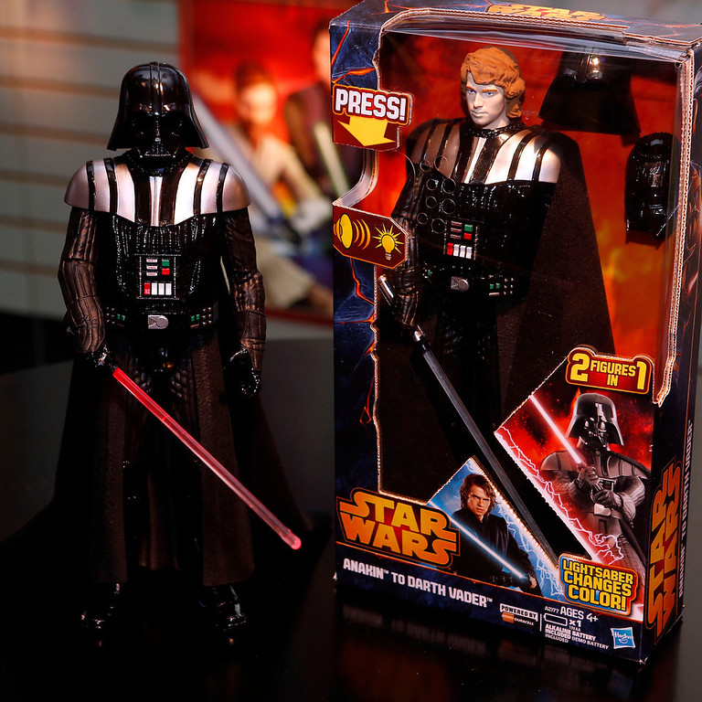 . These two figures are actually one ó Hasbroís STAR WARS ANAKIN TO VADER FIGURE action figure, which features snap-on Sith armor and both Anakin and Vader light and sound effects, is displayed in the companyís showroom at the American International Toy Fair, Saturday, Feb. 9, 2013, in New York. (Photo by Jason DeCrow/Invision for Hasbro/AP Images)