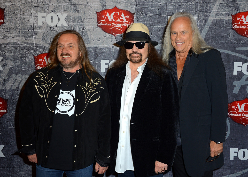 Description of . LAS VEGAS, NV - DECEMBER 10:  (L-R) Johnny Van Zant, Gary Rossington and Rickey Medlocke of Lynyrd Skynyrd arrive at the 2012 American Country Awards at the Mandalay Bay Events Center on December 10, 2012 in Las Vegas, Nevada.  (Photo by Frazer Harrison/Getty Images)