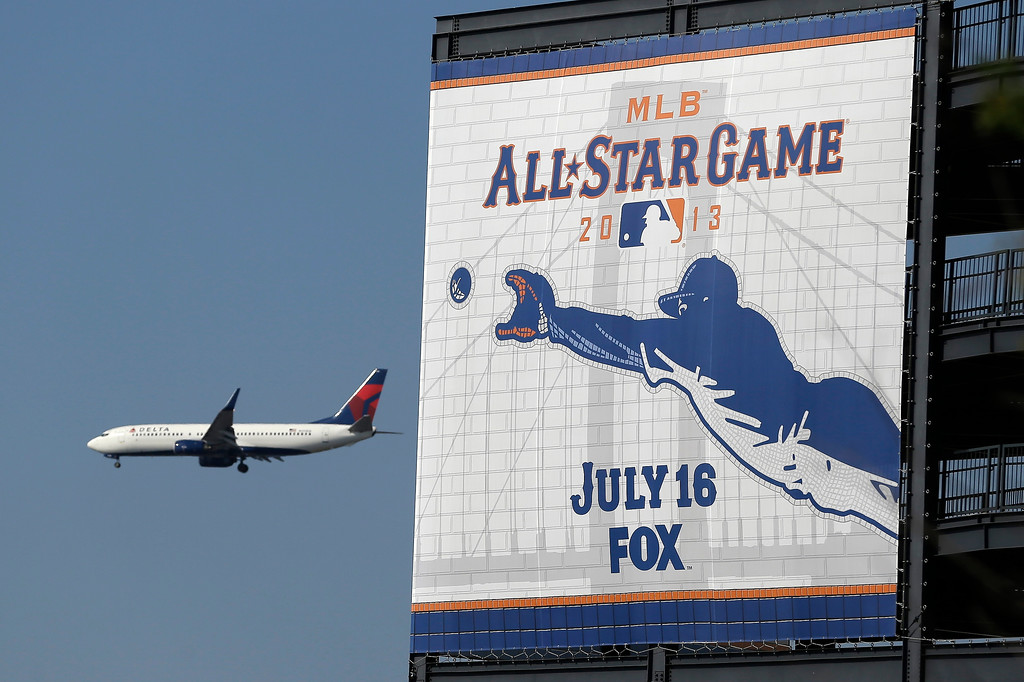 Description of . A plane flies past Citi Field on its way to La Guardia Airport before the MLB All-Star baseball game between the National and American Leagues, on Tuesday, July 16, 2013, in New York. (AP Photo/Julio Cortez)