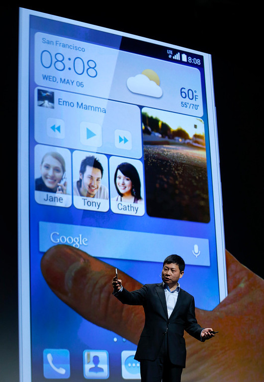 Description of . Huawei Consumer Business Group CEO Richard Yu discusses features of the Ascend Mate 2 4G smartphone during the International Consumer Electronics Show, Monday, Jan. 6, 2014, in Las Vegas. (AP Photo/Julie Jacobson)