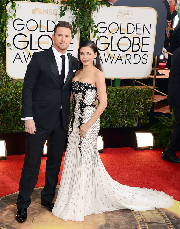 Description of . Channing Tatum, left, and Jenna Dewan arrive at the 71st annual Golden Globe Awards at the Beverly Hilton Hotel on Sunday, Jan. 12, 2014, in Beverly Hills, Calif. (Photo by Jordan Strauss/Invision/AP)