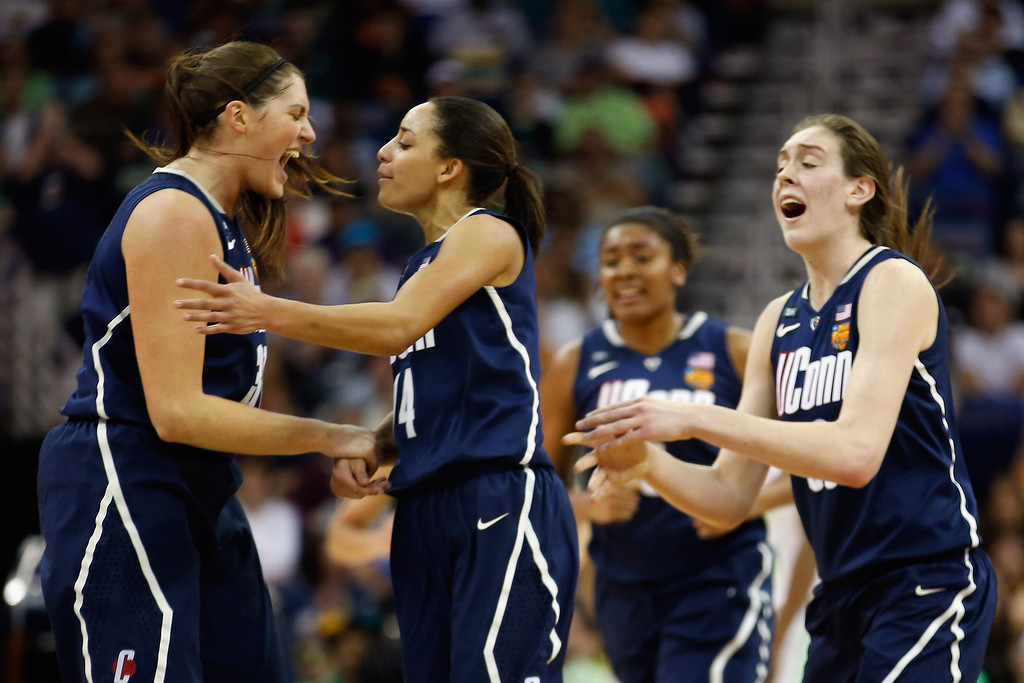 Description of . Members of the Connecticut Huskies react during the game against the Notre Dame Fighting Irish during the National Semifinal game of the 2013 NCAA Division I Women\'s Basketball Championship at the New Orleans Arena on April 7, 2013 in New Orleans, Louisiana.  (Photo by Chris Graythen/Getty Images)