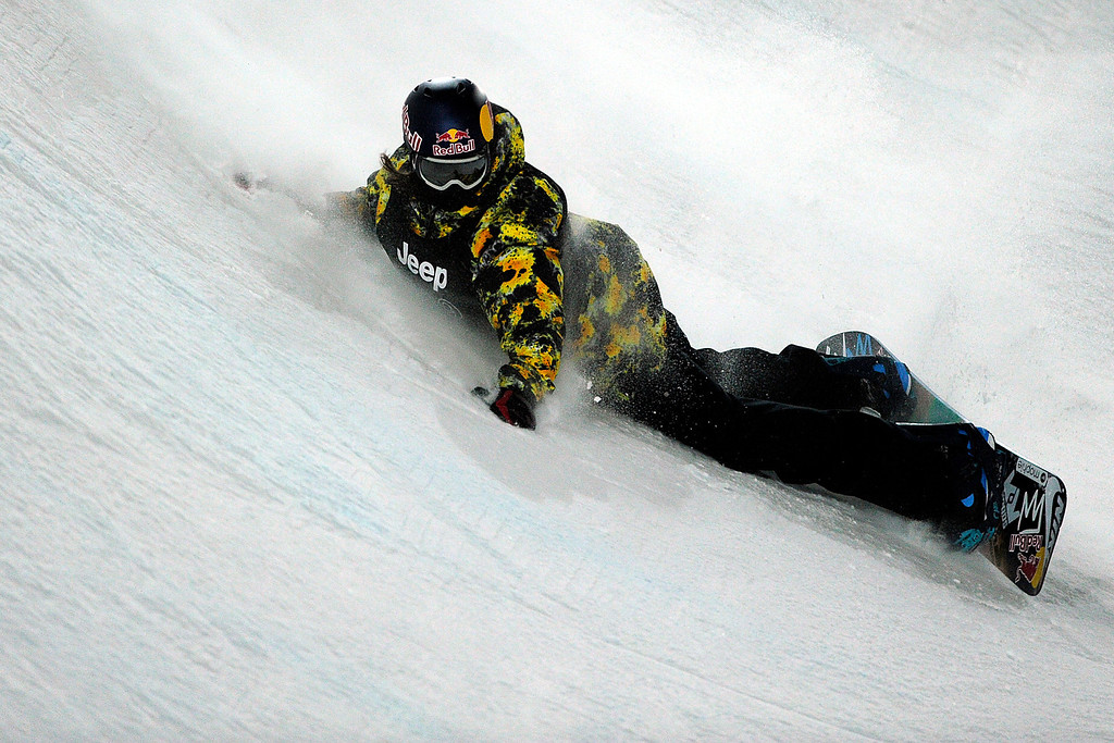 Description of . ASPEN, CO - JANUARY 27: Greg Bretz takes a spill during the men's snowboard superpipe final. X Games Aspen Buttermilk Mountain Aspen January 27, 2013. (Photo By Daniel Petty/The Denver Post)