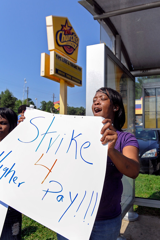 Description of . Church's Chicken employee Tina McCory protests low wages outside the fast food restaurant, Thursday, Aug. 29, 2013, in Atlanta. (AP Photo/John Amis)