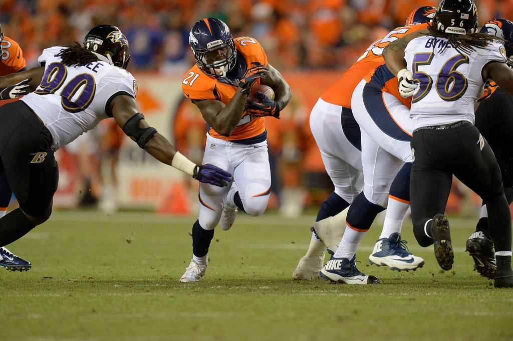 Description of . Denver Broncos running back Ronnie Hillman (21) runs through a hole in the line in the third quarter. The Denver Broncos took on the Baltimore Ravens in the first game of the 2013 season at Sports Authority Field at Mile High in Denver on September 5, 2013. (Photo by John Leyba/The Denver Post)