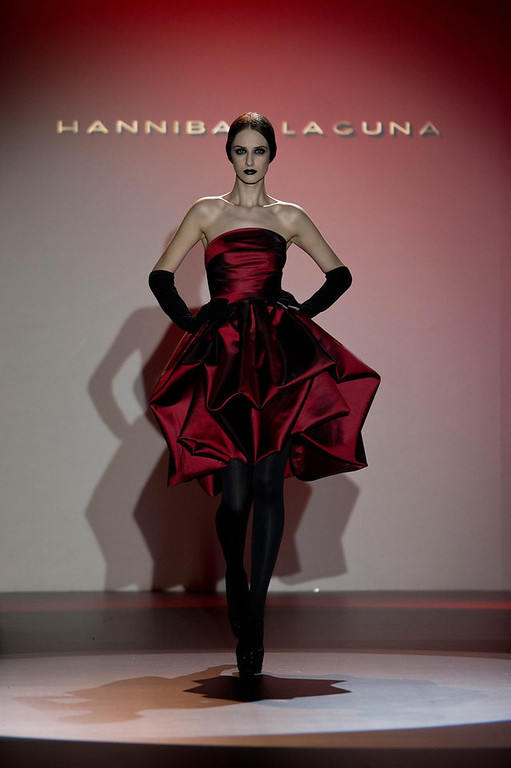 Description of . A model showcases designs by Hannibal Laguna on the runway at the Hannibal Laguna show during Mercedes Benz Fashion Week Madrid Fall/Winter 2013/14 at Ifema on February 18, 2013 in Madrid, Spain. (Photo by Gonzalo Arroyo Moreno/Getty Images)