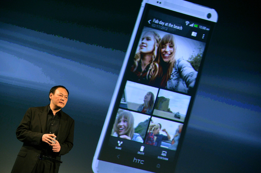 Description of . HTC CEO, Peter Chou, speaks during the launch of the HTC One smartphone in London February 19, 2013. REUTERS/Toby Melville