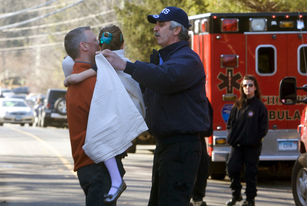Description of . A young girl is given a blanket after being evacuated from Sandy Hook Elementary School following a shooting in Newtown, Connecticut, December 14, 2012. At least 27 people, including children, were killed on Friday when at least one shooter opened fire at the elementary school in Newtown, Connecticut, CBS News reported, citing unnamed officials. REUTERS/Michelle McLoughlin