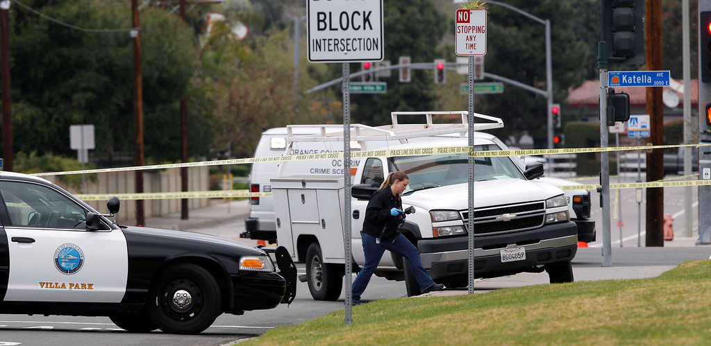 Description of . A forensic officer walks at the scene where a man killed himself after a shooting spree through several cities, in Villa Park, California February 19, 2013. A gunman on a shooting spree in suburban southern California shot and killed three people and wounded two others on Tuesday before killing himself, police said.  REUTERS/Alex Gallardo