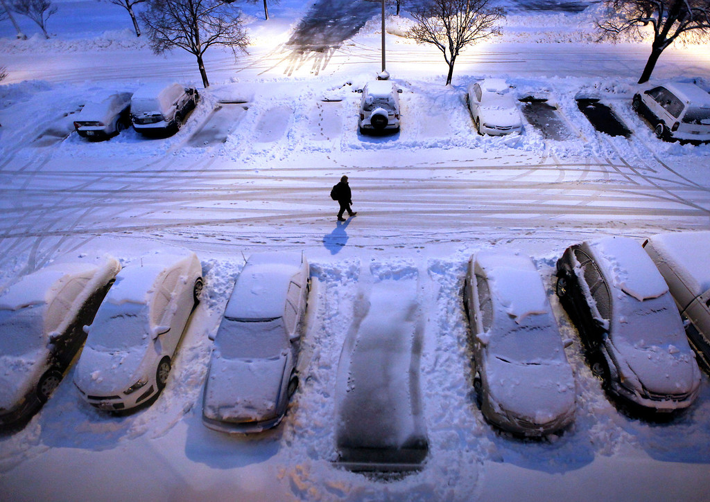 Description of . Snow-covered cars in a parking lot greet early morning risers in Madison, Wis. as a severe winter storm moves through the upper Midwest Thursday, Dec. 20, 2012. (AP Photo/Wisconsin State Journal, John Hart)