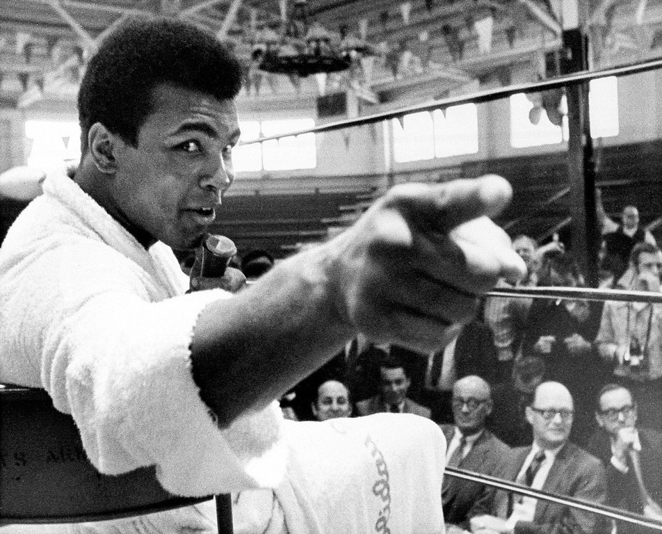 Description of . Heavyweight boxer Muhammad Ali makes a point during a news conference that he conducts from inside the ring in Atlanta, Ga., in this Oct. 24, 1970, file photo. A new book,