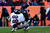 Baltimore Ravens tight end Dennis Pitta (88) is taken down by Denver Broncos free safety Rahim Moore (26) after catching a 16-yard pass in the first quarter. The Denver Broncos vs Baltimore Ravens AFC Divisional playoff game at Sports Authority Field Saturday January 12, 2013. (Photo by AAron  Ontiveroz,/The Denver Post)