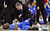 Air Force head coach Dave Pilipovich tends to Michael Lyons on the court after Lyons was hurt in the first half of a Mountain West Conference tournament NCAA college basketball game against UNLV, Wednesday, March 13, 2013, in Las Vegas. (AP Photo/Isaac Brekken)