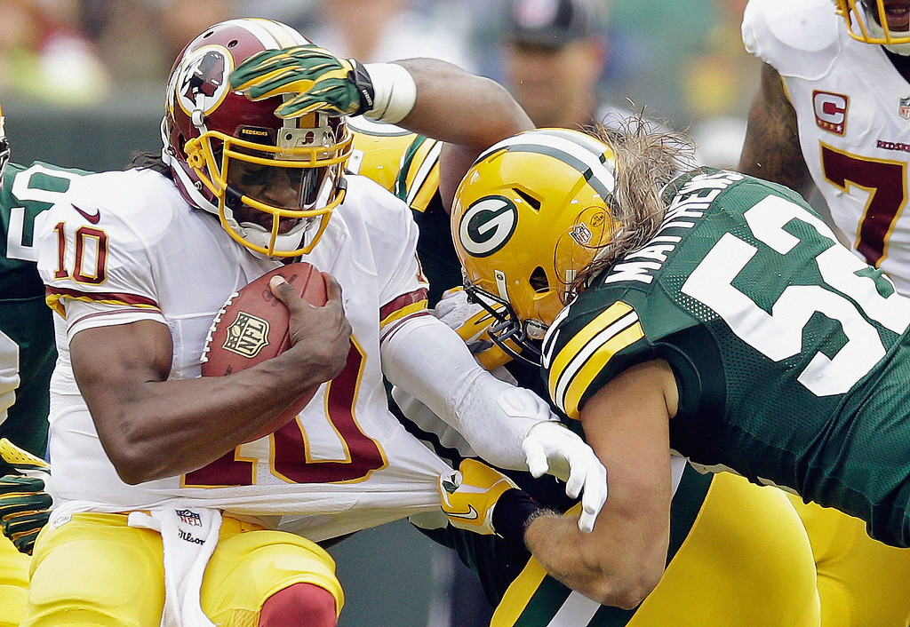 Description of . Washington Redskins quarterback Robert Griffin III (10) is sacked by Green Bay Packers outside linebacker Clay Matthews during the first half of an NFL football game Sunday, Sept. 15, 2013, in Green Bay, Wis. (AP Photo/Tom Lynn)