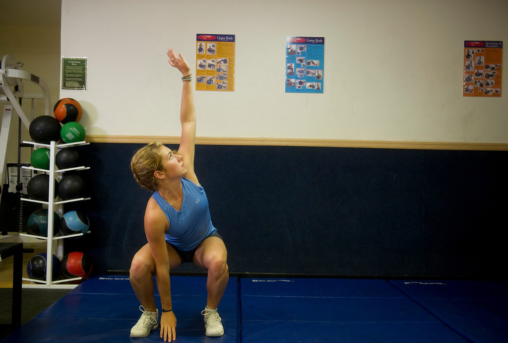 Description of . Olympic downhill skier Mikaela Shiffrin stretches before a morning workout at the Homestead Club in Edwards, Co. on July 15, 2013. (Photo By Grant Hindsley/The Denver Post)