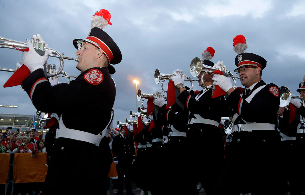 Description of . The Ohio State marching fan performs for fans before the Orange Bowl NCAA college football game between Clemson and Ohio State, Friday, Jan. 3, 2014, in Miami Gardens, Fla. (AP Photo/Lynne Sladky)