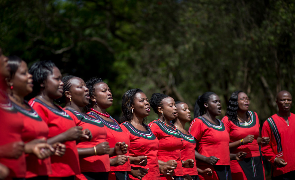 Description of . A Kenyan choir sings at a memorial service and tree-planting marking the one-month anniversary of the the Sept. 21 Westgate Mall terrorist attack, in Karura Forest in Nairobi, Kenya Monday, Oct. 21, 2013. (AP Photo/Ben Curtis)