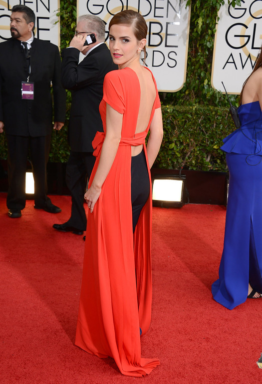 Description of . Emma Watson arrives at the 71st annual Golden Globe Awards at the Beverly Hilton Hotel on Sunday, Jan. 12, 2014, in Beverly Hills, Calif. (Photo by Jordan Strauss/Invision/AP)