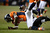 Denver Broncos wide receiver Trindon Holliday (11) is tackled far in the Broncos end on a punt return in overtime. The Denver Broncos vs Baltimore Ravens AFC Divisional playoff game at Sports Authority Field Saturday January 12, 2013. (Photo by Joe Amon,/The Denver Post)