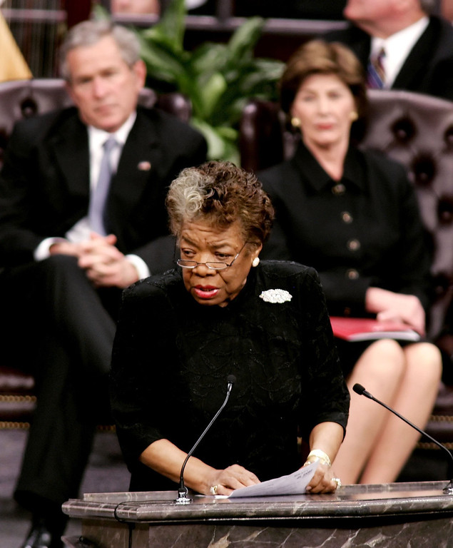 . Maya Angelou speaks during the funeral services for Coretta Scott King at the New Birth Missionary Baptist Church February 7, 2006 in Lithonia, Georgia. Coretta Scott King, the wife of slain civil rights leader Martin Luther King Jr., died January 30 at the age of 78. Seated behind Angelou is U.S. President George W. Bush and first lady Laura Bush.  (Photo by Jason Reed-Pool/Getty Images)