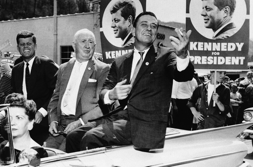 Description of . The political magic of his father's name rides with Franklin D. Roosevelt Jr., right, as he tours West Virginia with then Sen. John F. Kennedy on April 27, 1960, during Kennedy's campaign for the Democratic presidential nomination. State Sen. Ward Wylie, left, was Kennedy's West Virginia campaign chairman. Associated Press file