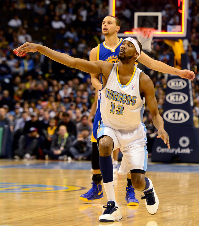 Description of . Denver Nuggets small forward Corey Brewer (13) and Golden State Warriors point guard Stephen Curry (30) watch a last-second shot in the first quarter during the first half at the Pepsi Center on Sunday, January 13, 2013. AAron Ontiveroz, The Denver Post