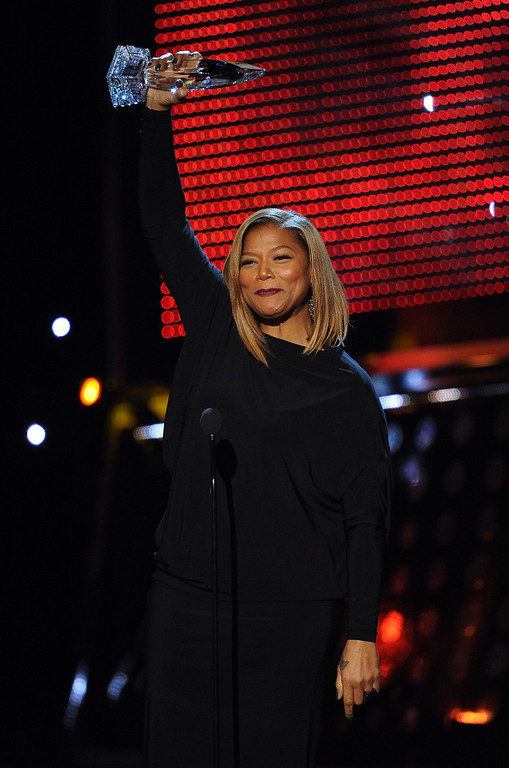 Description of . LOS ANGELES, CA - JANUARY 08:  TV personality Queen Latifah accepts the Favorite New Talk Show Host award onstage at The 40th Annual People's Choice Awards at Nokia Theatre L.A. Live on January 8, 2014 in Los Angeles, California.  (Photo by Kevin Winter/Getty Images)